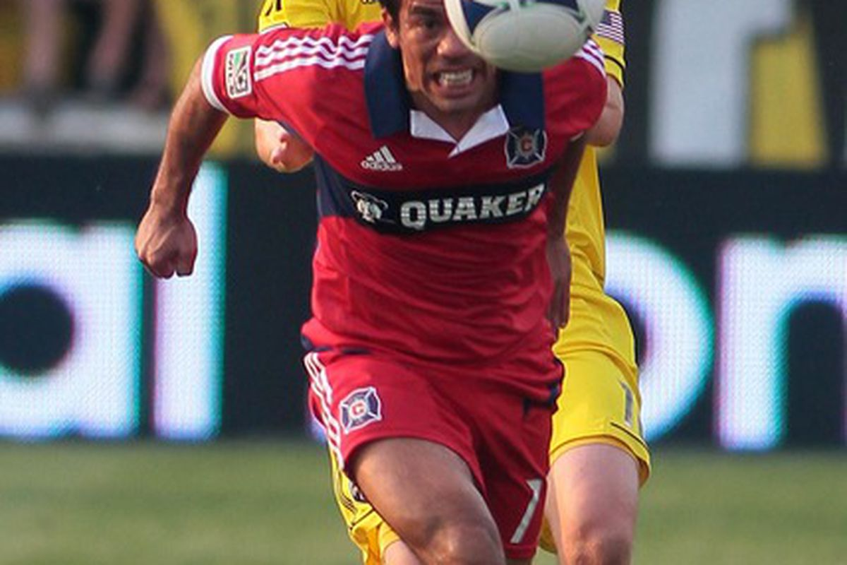 May 26, 2012; Columbus, OH, USA;  Chicago Fire midfielder Pavel Pardo (front) heads the ball as Columbus Crew  midfielder Eddie Gaven looks on during the game at Crew Stadium. Mandatory Credit: Tony Tribble-US PRESSWIRE