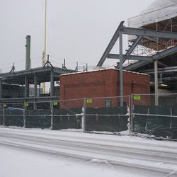 Wide view of all the work taking place in the left field corner