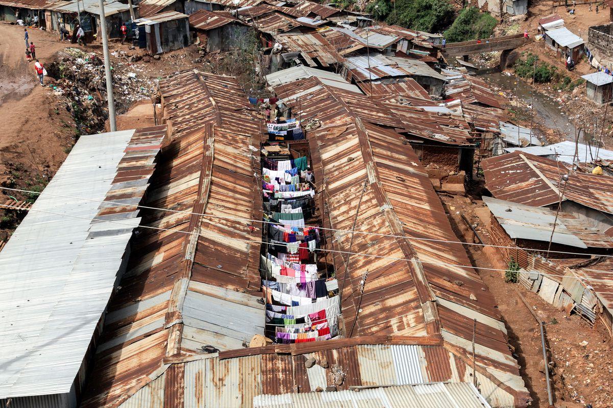 Washed clothes hung between shacks in Kibera, Nairobi, Kenya, in 2014.