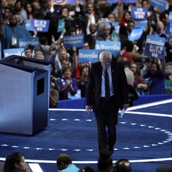 Former Democratic Presidential candidate, Sen. Bernie Sanders, I-Vt., walks off the stage after speaking to delegates during the first day of the Democratic National Convention in Philadelphia , Monday, July 25, 2016. (AP Photo/John Locher)