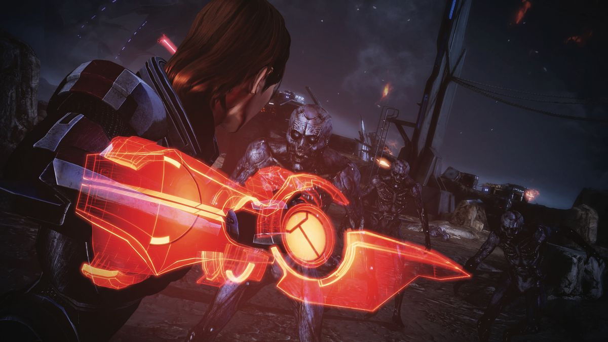 female Shepard fighting aliens with an Omni Blade in Mass Effect Legendary Edition