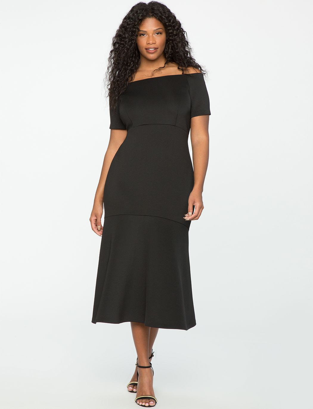 60ccb801cc8 A model in a black off-the-shoulder gown