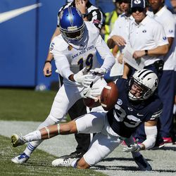 Brigham Young Cougars wide receiver Beau Tanner can't pull in a pass while defended by San Jose State Spartans cornerback Cameron Smith during NCAA football in Provo on Saturday, Oct. 28, 2017.
