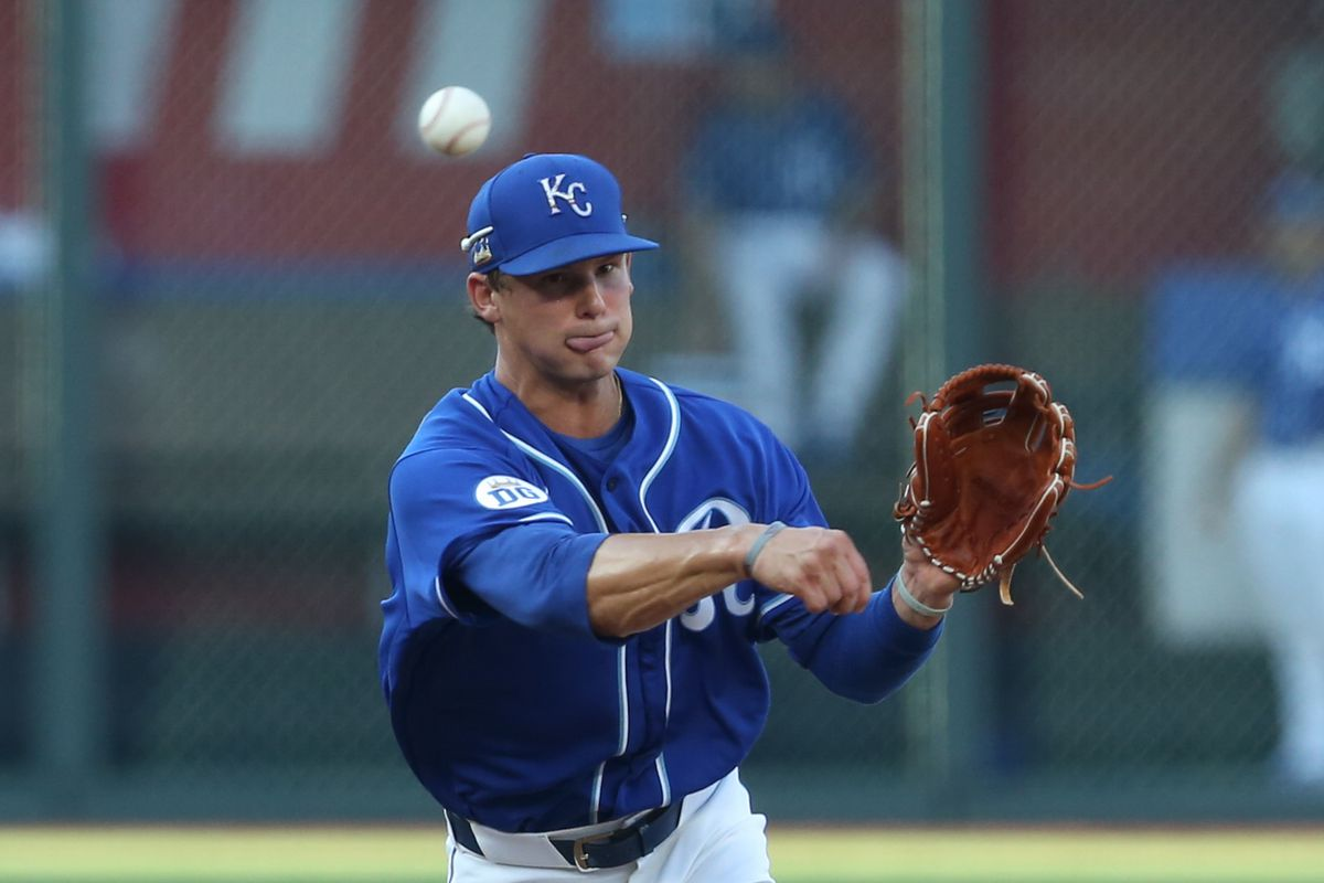 Kansas City Royals shortstop Bobby Witt Jr. (90) comes up throwing after fielding a grounder during the Royals summer camp workouts on July 08, 2020 at Kauffman Stadium in Kansas City, MO.