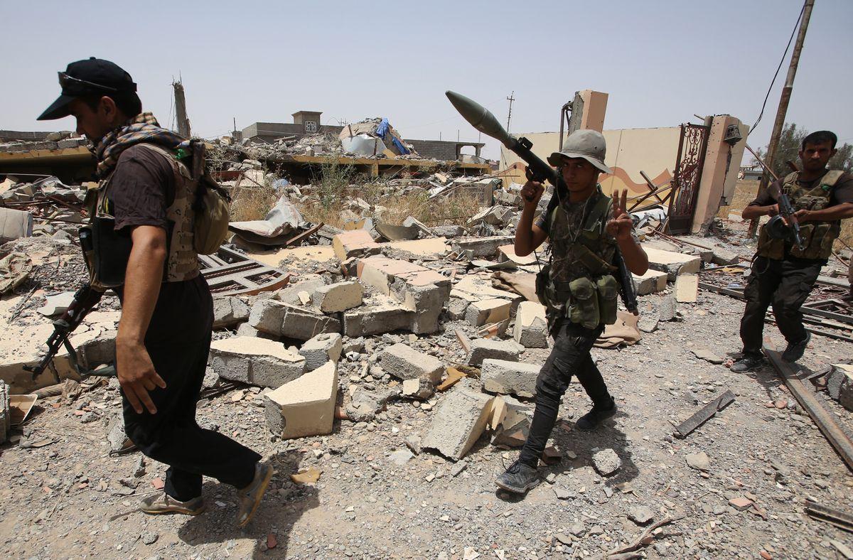 Iraqi Shia militiamen north of Tikrit (AHMAD AL-RUBAYE/AFP/Getty)