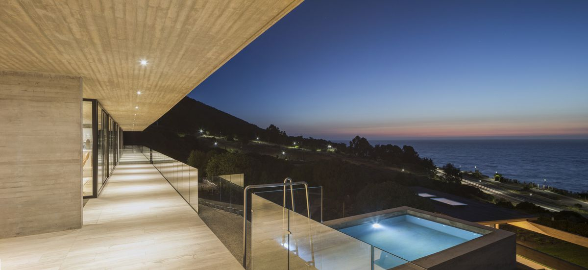 Cantilevered swimming pool at night