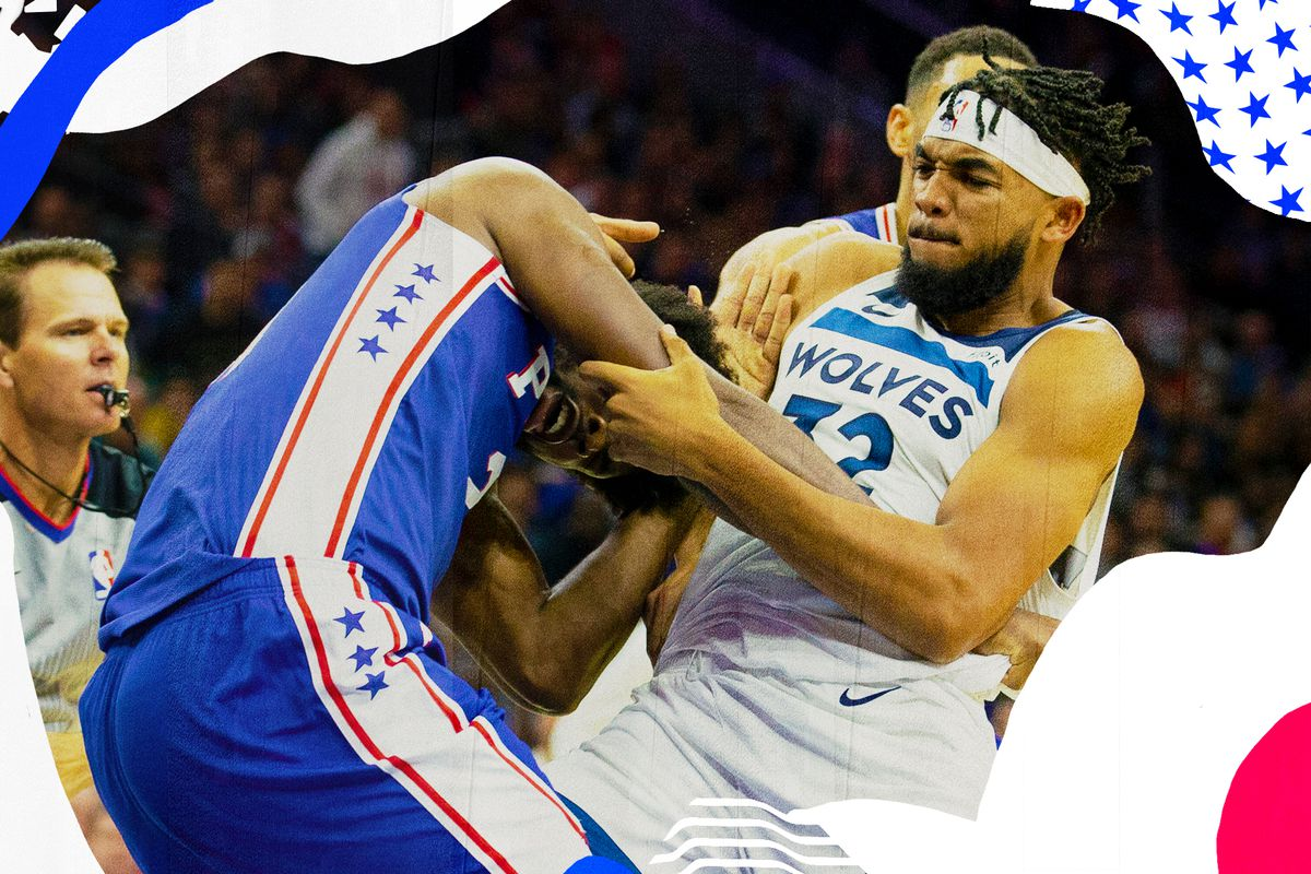 Joel Embiid and Karl-Anthony Towns wrestle on the court.