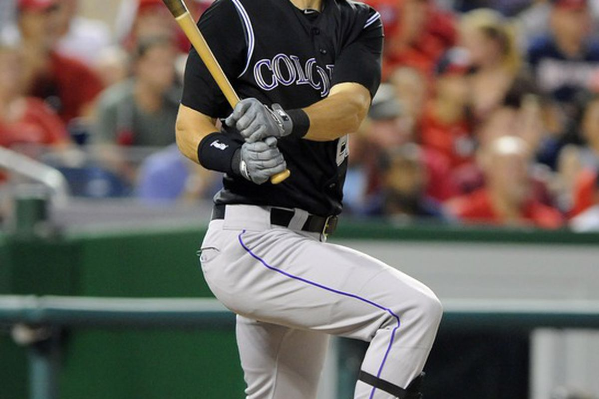 Washington, DC, USA; Colorado Rockies first baseman Tyler Colvin (21) singles against the Washington Nationals during the sixth inning at Nationals Park. The Rockies defeated the Nationals 5 - 1. Mandatory Credit: Brad Mills-US PRESSWIRE