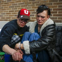 """Criss, left, comforts Karren Cardenas, 45, right,  outside the Catholic Community Services 200 S and 500 W next to the Road Home, called """"The Block,"""" in Salt Lake City on Wednesday, March 8, 2017. Karren has lived on the street for seven years and hasn't seen her father or her six children in years. She suffers from nerve damage, high blood pressure and PTSD."""