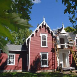 This Sept. 8, 2012, photo shows the historic Strevell House in Pontiac, Ill., as a new roof is worked on as part of a full-scale renovation. The Livingston County Historical Society bought the Pontiac landmark, the last known structure in Livingston County to have hosted Abraham Lincoln before he was elected president.