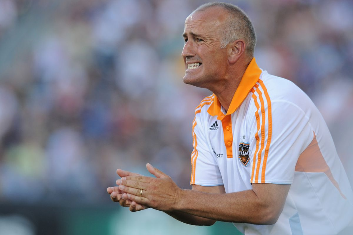 COMMERCE CITY, CO - JULY 3:   Head Coach Dominic Kinnear of the Houston Dynamo reacts to a play against the Colorado Rapids at Dick's Sporting Goods Park on July 3, 2011 in Commerce City, Colorado.  (Photo by Bart Young/Getty Images)