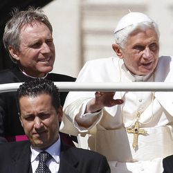 """FILE - In this file photo taken Wednesday, May 2, 2012, Pope Benedict XVI arrives in St. Peter's square at the Vatican for a general audience as his then-butler Paolo Gabriele, bottom, and his personal secretary Georg Gaenswein sit in the car with him. Pope Benedict XVI's ex-butler Paolo Gabriele and another Vatican lay employee, Claudio Sciarpelletti, are scheduled to go on trial Saturday, Sept. 29, 2012, in the embarrassing theft of papal documents that exposed alleged corruption at the Holy See's highest levels. Gabriele was arrested May 24 after Vatican police found what prosecutors called an """"enormous'' stash of documents from the pope's desk in his Vatican City apartment."""