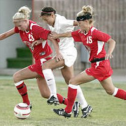 Two Lobo defenders steal the ball from Utah Forward Adele Letro (middle). THe Lobos upset the No. 1 seed Utes 1-0 in the second round of the MWC tournament.