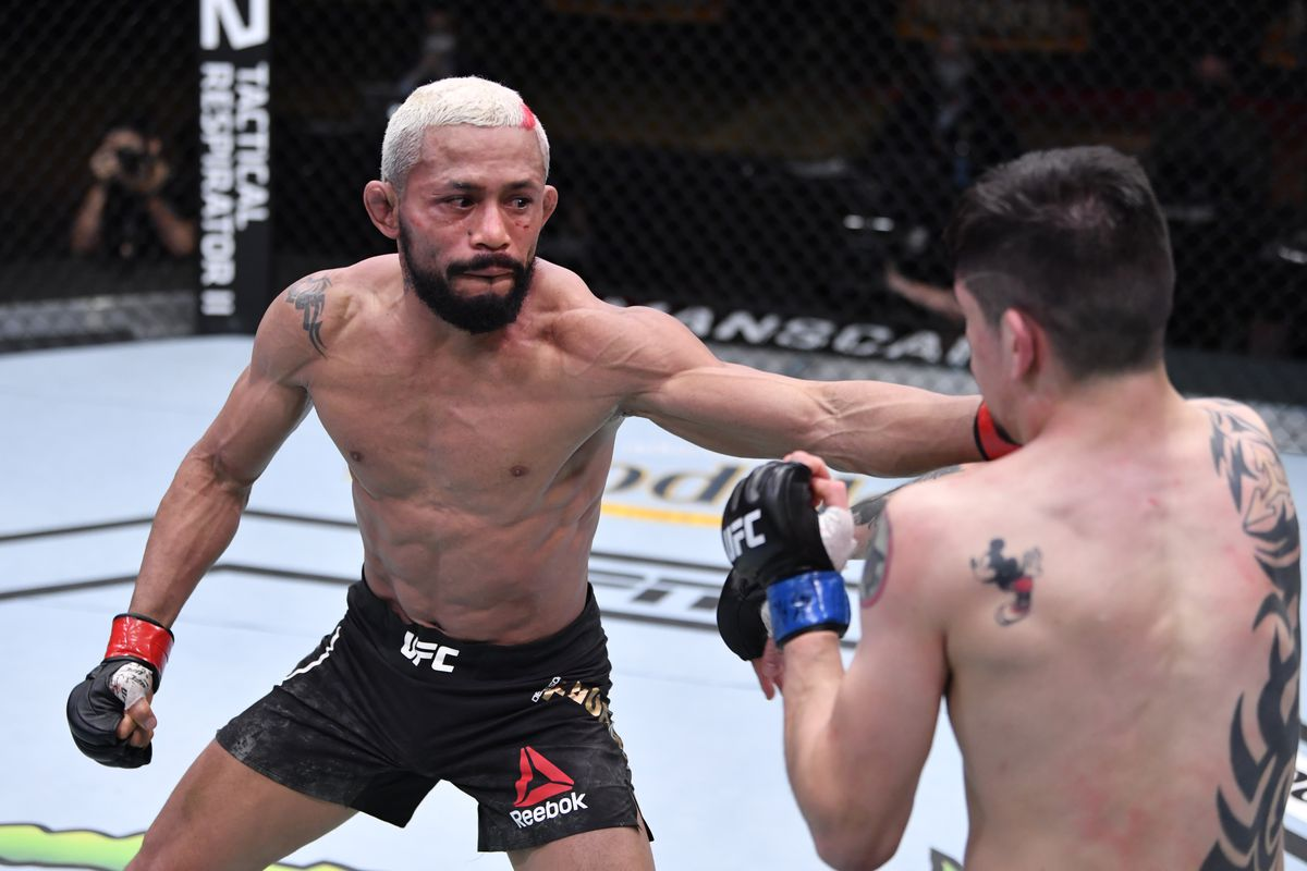 Deiveson Figueiredo of Brazil punches Brandon Moreno of Mexico in their flyweight championship bout during the UFC 256 event at UFC APEX on December 12, 2020 in Las Vegas, Nevada.