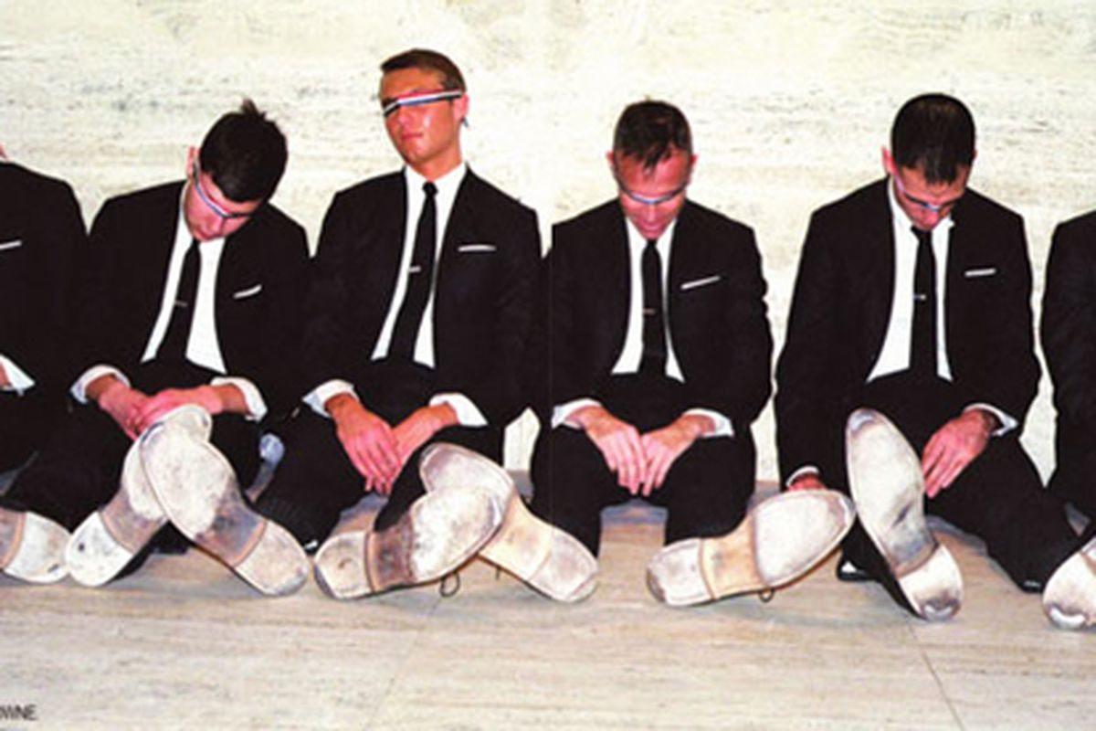 """This 2009 Thom Browne print ad seems apt. Image via <a href=""""http://www.selectism.com/news/2009/03/24/thom-browne-print-ad/"""">Selectism</a>."""