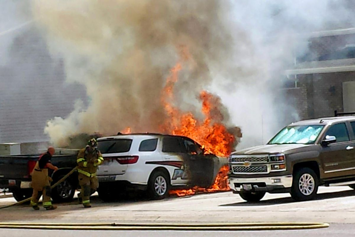A Roosevelt police officer's patrol vehicle and his personal pickup truck were destroyed by fire Tuesday at the officer's home. Roosevelt firefighters suspect the fire was caused by a problem with a pair of jumper cables that connected the two vehicles.