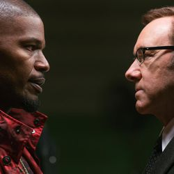 """Doc (Kevin Spacey) has a word with Bats (Jamie Foxx) in """"Baby Driver."""""""