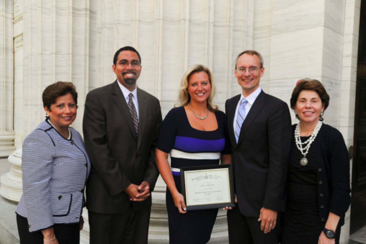 Ashli Skura Dreher, middle, is recognized in 2013 as New York State's Teacher of the Year. She is defending tenure in a lawsuit challenging the state's job protection laws.