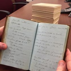 """Alex D. Smith, a volume editor of the """"Joseph Smith Papers, Journals Volume 3,"""" holds one of Joseph Smith's four small journals at the Church History Library."""