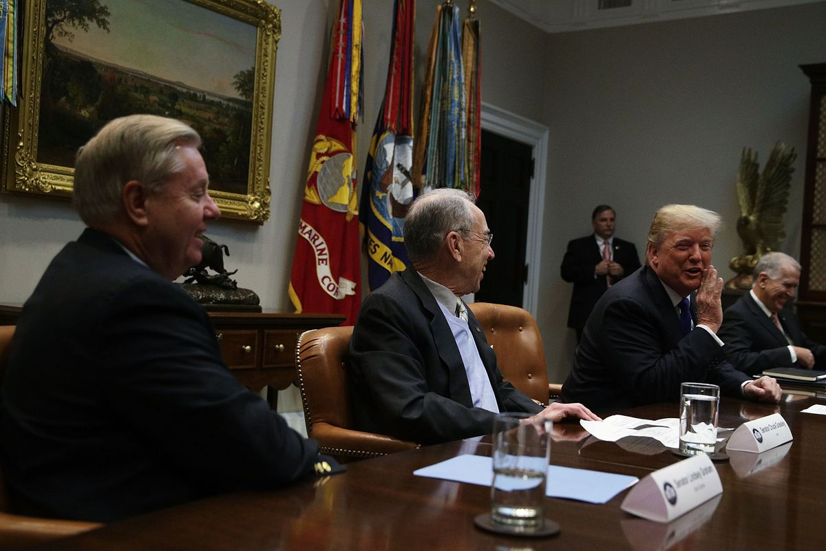 Senators Lindsey Graham and Chuck Grassley in a White House meeting with President Donald Trump.