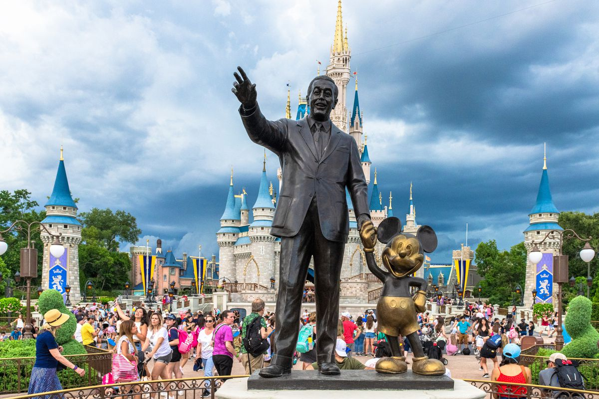 Walt Disney and Mickey Mouse statue inside of the Magic...