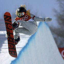 FILE- In this Feb. 13, 2018, file photo, Chloe Kim, of the United States, jumps during the women's halfpipe finals at Phoenix Snow Park at the 2018 Winter Olympics in Pyeongchang, South Korea. Before Kim won gold in the snowboarding halfpipe event, her infectious personality and heartwarming origin story had already won her sponsorships from Toyota, Samsung, Visa and others.