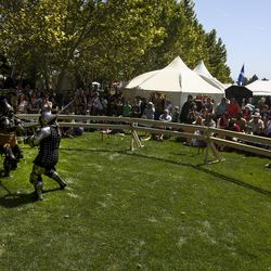 Fighters with the Armored Combat League compete during the Utah Renaissance Faire at Thanksgiving Point's Electric Park in Lehi on Friday, Aug. 23, 2019.