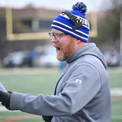 Phillips head coach Troy McAllister calls in a play. Worsom Robinson/For the Sun-Times.
