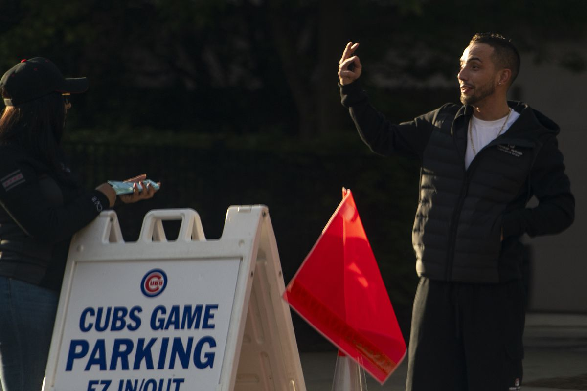 Premium 1 Parking owner DylanCirkicat a Chicago Public Schools owned-lot at 3830 N. Southport Ave. during a Cubs game Monday night.