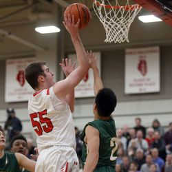 Benet Academy's Colin Crothers (55) scores and is fouled by Stevenson's Luke Chieng (2) during their 63-59 win in Lisle, Saturday, February 16, 2019.   Kevin Tanaka/For the Sun Times