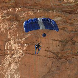 Matt Gold opens his chute after jumping off a ski ramp at the top of the 600-foot cliffs in Utah's Echo Canyon.