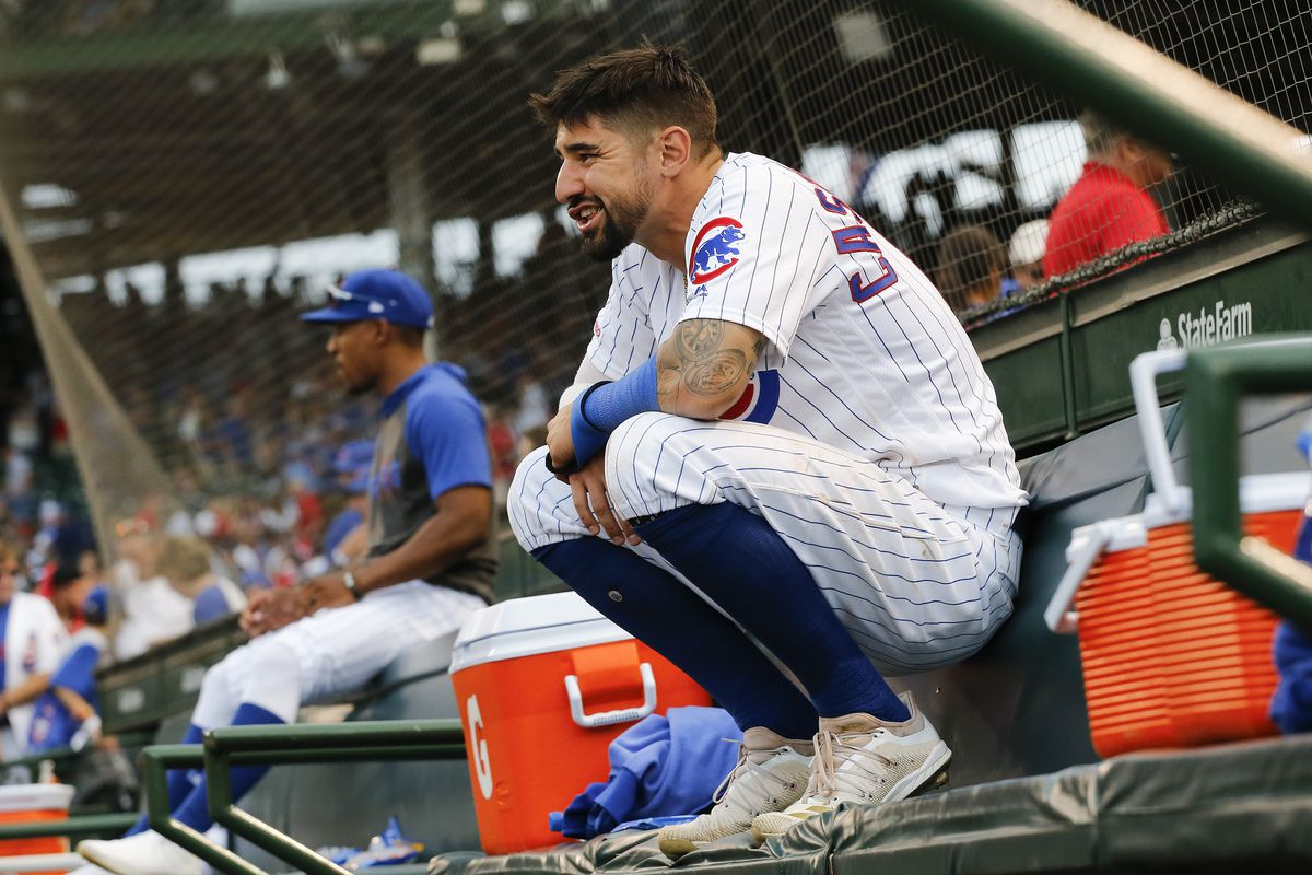 Nicholas Castellanos #6 of the Chicago Cubs lingers in the dugout for a couple extra minutes following his team's 9-8 loss to the St. Louis Cardinals at Wrigley Field on September 21, 2019 in Chicago, Illinois.