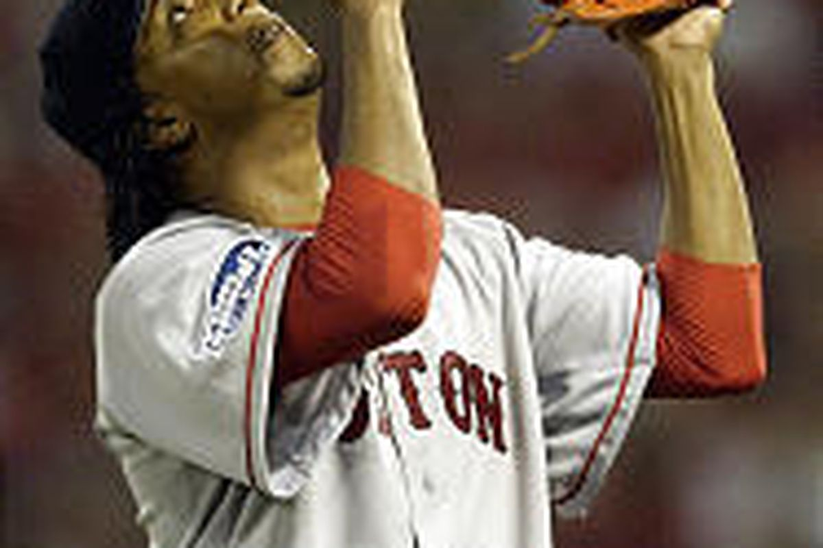 Red Sox pitcher Pedro Martinez points to the sky as he walks off the field after retiring the Cardinals in the seventh inning Tuesday.