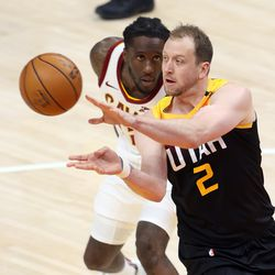 Utah Jazz guard Joe Ingles (2) passes the ball with Cleveland Cavaliers forward Taurean Prince (12) behind him as the Utah Jazz and the Cleveland Cavaliers play an NBA basketball game at Vivint Smart Home Arena in Salt Lake City on Monday, March 29, 2021. Utah won 114-75.