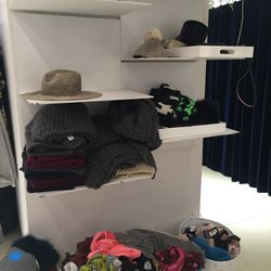 Accessories, including scarves, beanies, and straw hats