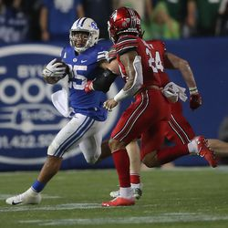 Brigham Young Cougars running back Tyler Allgeier (25) looks for running room as BYU and Utah play an NCAA football game at LaVell Edwards Stadium in Provo on Saturday, Sept. 11, 2021. BYU won 26-17, ending a nine-game losing streak to the Utes.