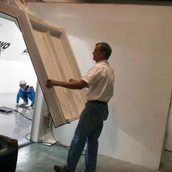 Layne Christensen, founder of Darko Technologies closes the door of his 100-foot-long wind tunnel as members of Women's Ski Jumping USA team try it out in Ogden's Business Depot on Thursday, Sept. 26, 2013.