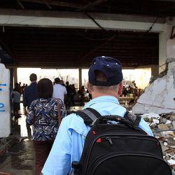 Passengers arrive at the damaged Tacloban airport, Thursday, Nov. 21, 2013.