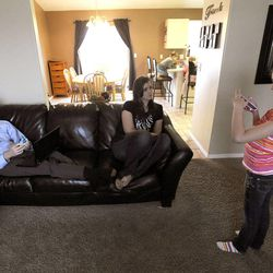 Savanna, 10, talks with mom, Emily, as Jeff checks on his reservations for his upcoming tournament in Las Vegas in their home in West Jordan on Thursday, Feb. 27, 2014.