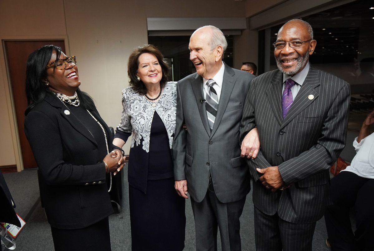 President Russell M. Nelson of The Church of Jesus Christ of Latter-day Saints and his wife, Sister Wendy Nelson, share a laugh with Reverend Theresa Dear, left, and Dr. Amos Brown, right, at the 110th annual national convention for the National Association for the Advancement of Colored People in Detroit, Michigan, on Sunday, July 21, 2019.