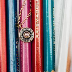 "<a href=""http://shopthemansion.com/products/rose-cut-diamond-pendant-necklace"">Rose Cut</a> Diamond Pendant Necklace ($760)"