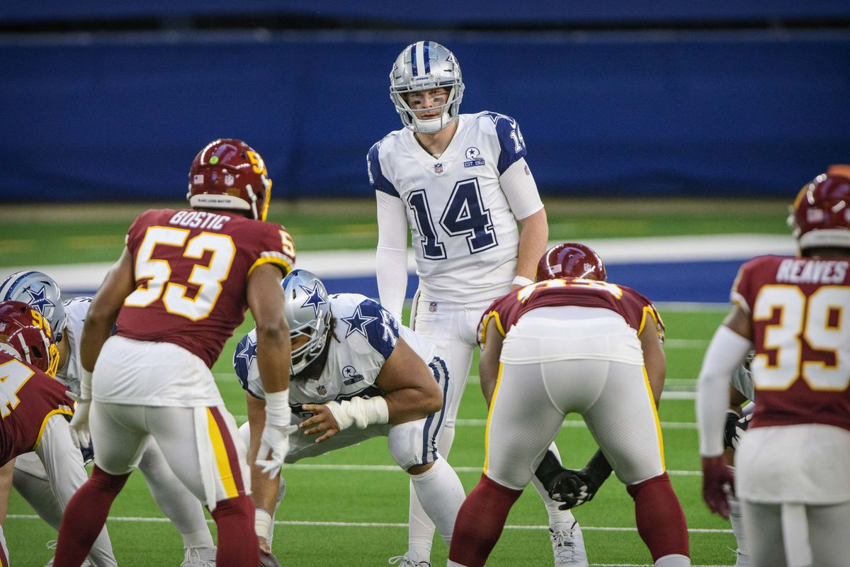 Dallas Cowboys quarterback Andy Dalton (14) in action during the game between the Dallas Cowboys and the Washington Football Team at AT&T Stadium.