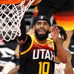 Utah Jazz guard Mike Conley (10) puts in a shot as the Utah Jazz and the Brooklyn Nets play an NBA basketball game at Vivint Smart Home Arena in Salt Lake City on Wednesday, March 24, 2021. Utah won 118-88.
