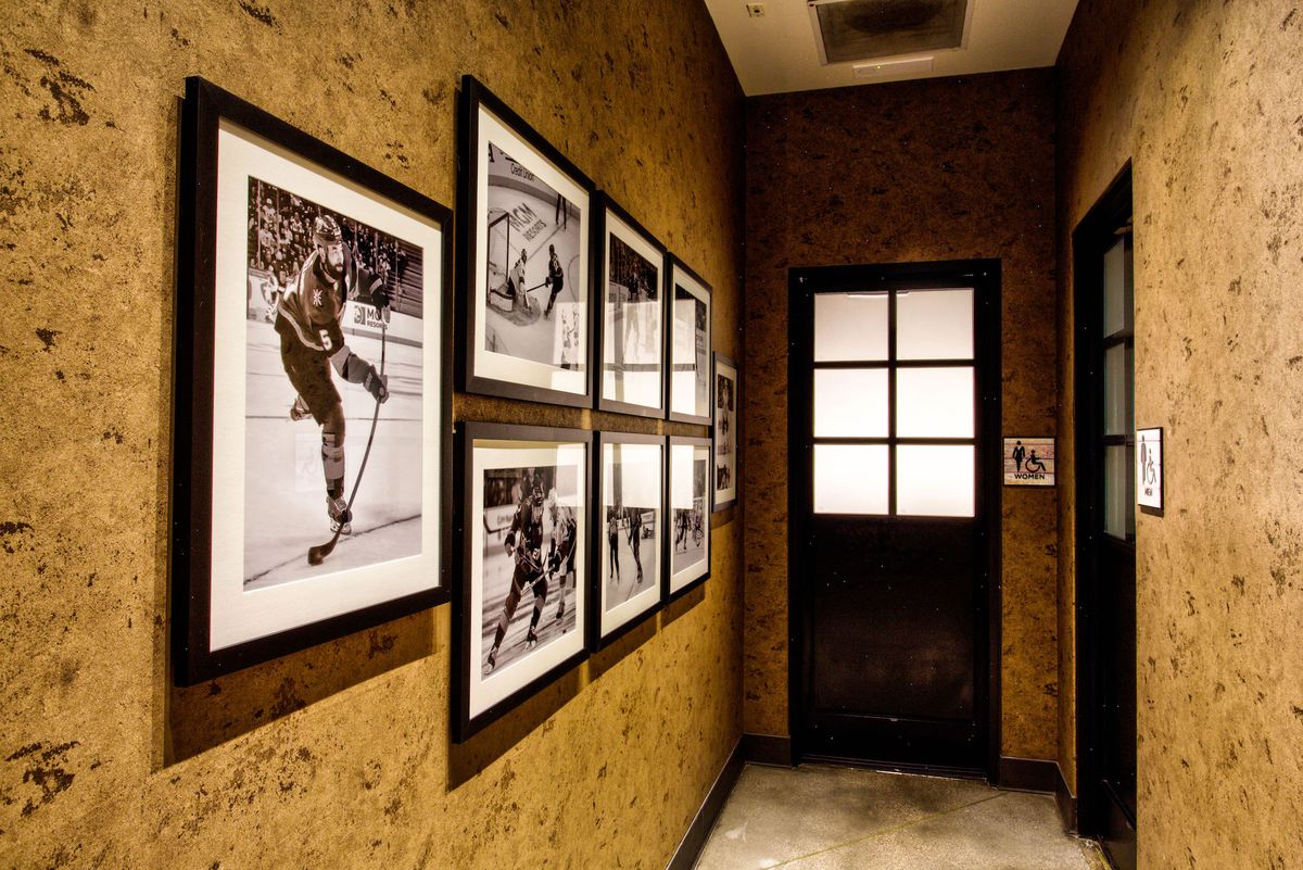 The wall to the bathrooms at Wolfgang Puck Players Locker