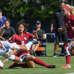 Kansas State forward Katie Cramer (20) and Oklahoma midfielder Kaylee Dao (11) tumble to the ground during a match on Sunday, Sept. 23, 2018, in Manhattan.