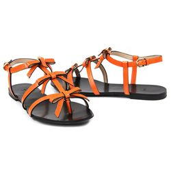 """Better than fresh Island Creek oysters. Viktor & Rolf 3 Tier Bow Sandal, $695 at <a href=""""http://curatedbythetannery.com/products/3-tier-bow-sandal"""">The Tannery</a>."""