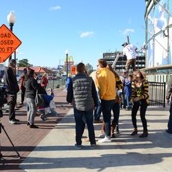Sat 3:23 p.m. Crowd in front of the ballpark, taking photos -