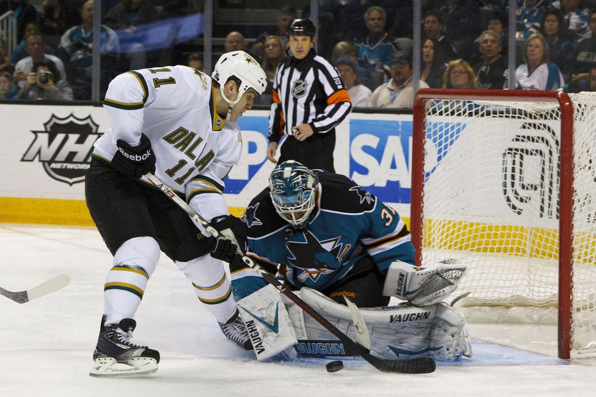 Mar 31, 2012; San Jose, CA, USA; San Jose Sharks goalie Antti Niemi (31) saves a shot in front of Dallas Stars center Jake Dowell (11) during the second period at HP Pavilion. Mandatory Credit: Jason O. Watson-US PRESSWIRE