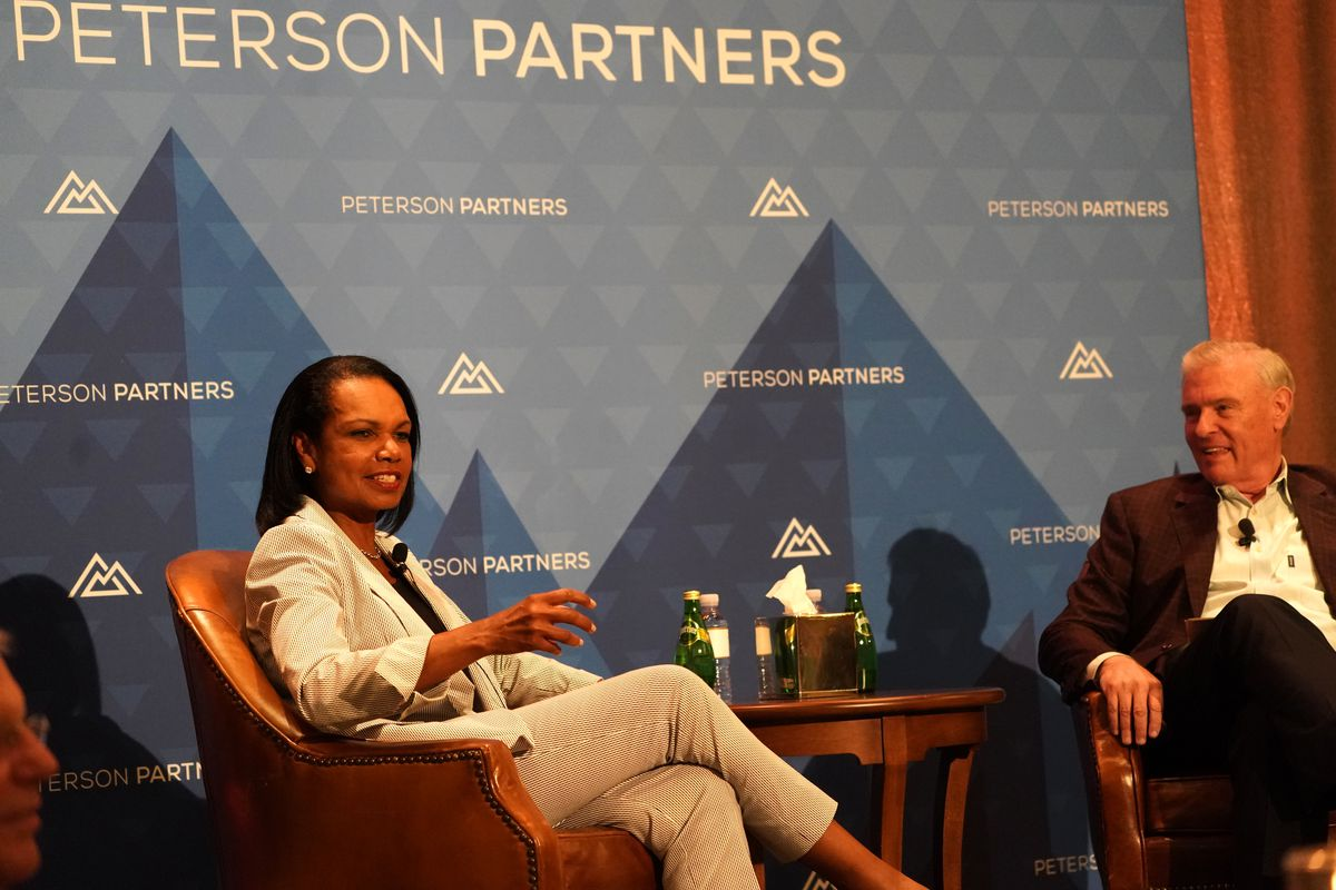Former Secretary of State Condoleezza Rice speaks on stage next to Joel Peterson, chairman of JetBlue, during the annual Peterson Partners Investor & CEO conference, in Park City, Aug. 28.