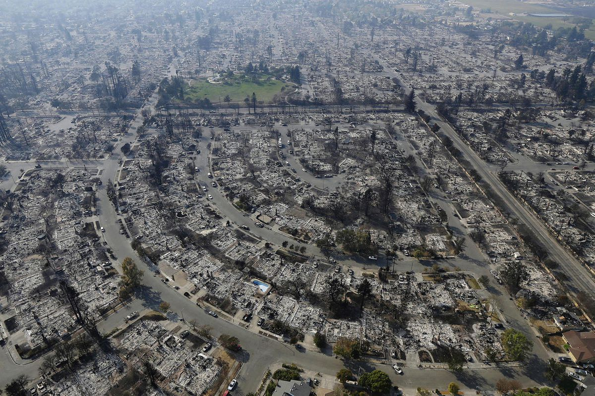 Homes burned by a wildfire are seen Wednesday, Oct. 11, 2017, in Santa Rosa, Calif. Wildfires whipped by powerful winds swept through Northern California sending residents on a headlong flight to safety through smoke and flames as homes burned. (AP Photo/